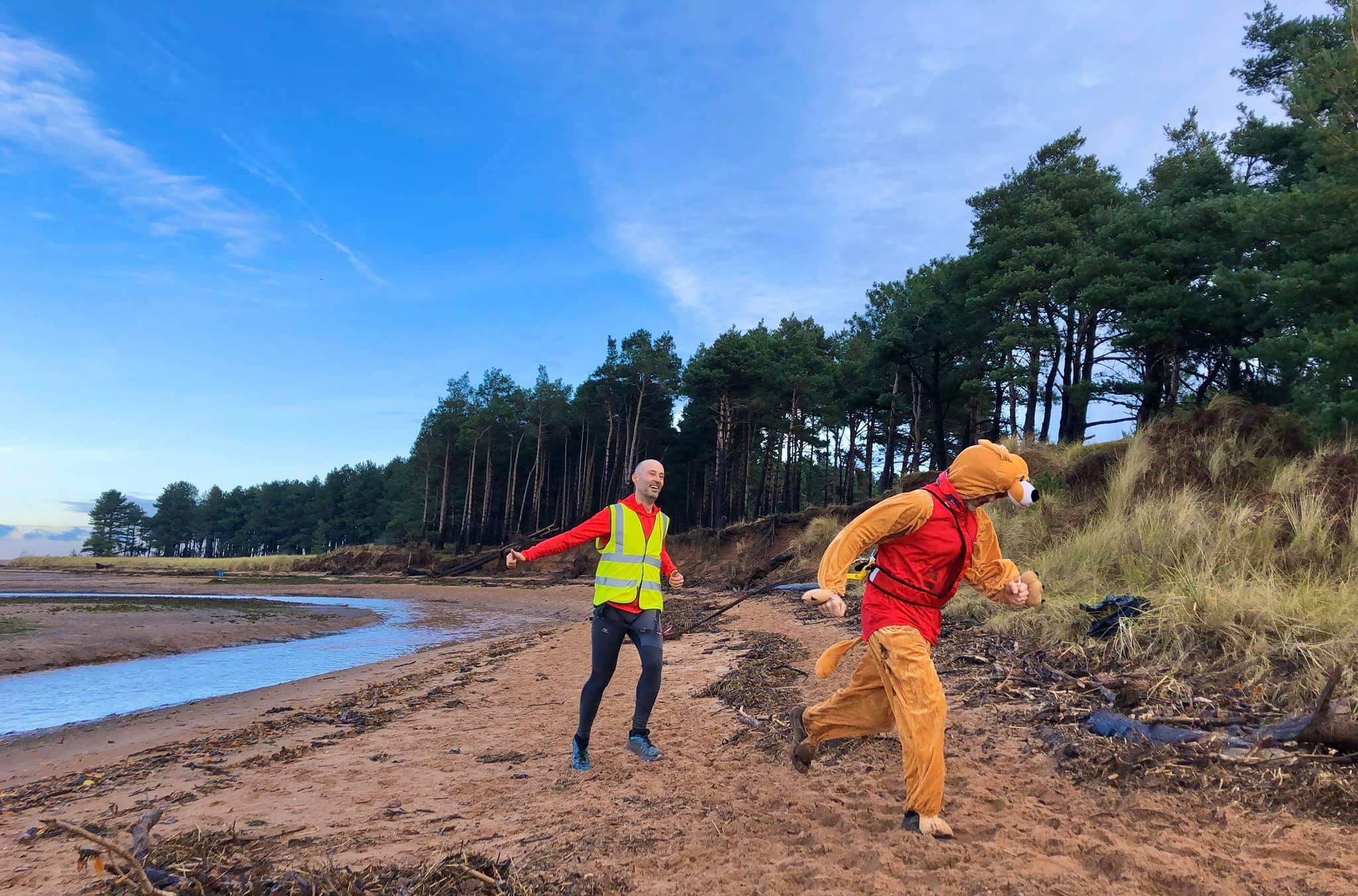 canicross runners on beach